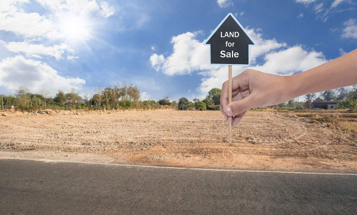 Empty land plot for housing construction project and beautiful blue sky with fresh air Land for sale