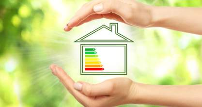 Female hands and house with energy efficiency scale image on natural background