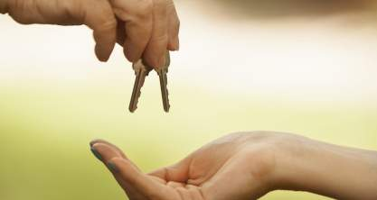 Handing the keys to a new home owner
